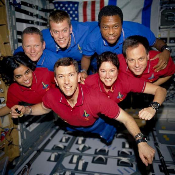 This image of the STS-107 shuttle Columbia crew in orbit was recovered from wreckage inside an undeveloped film canister. The shirt colors indicate their mission shifts. From left (bottom row): Kalpana Chawla, mission specialist; Rick Husband, commander; Laurel Clark, mission specialist; and Ilan Ramon, payload specialist. From left (top row) are astronauts David Brown, mission specialist; William McCool, pilot; and Michael Anderson, payload commander. Ramon represents the Israeli Space Agency.