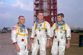 "From left, Apollo 1 astronauts Virgil I. ""Gus"" Grissom, Edward White and Roger Chaffee pose in front of their Saturn 1 launch vehicle at Launch Complex 34 at the Kennedy Space Center. The astronauts later died in a fire on the pad."