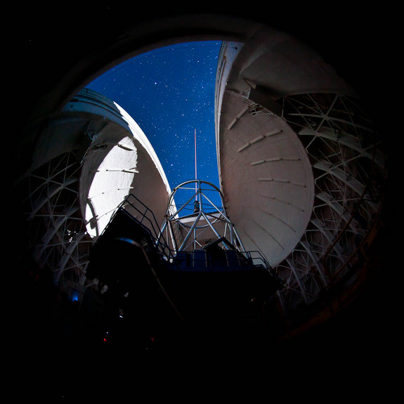 An interior view of the Gemini South during propagation of the laser guide star system during on-sky testing of the laser system.