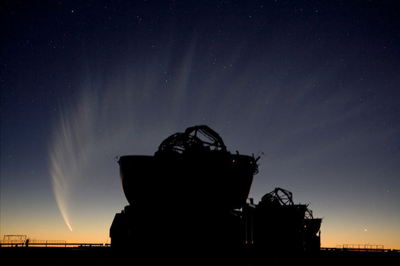 The sweeping image showcases Comet McNaught after sunset, with two Auxiliary Telescopes of the VLTI in the foreground.