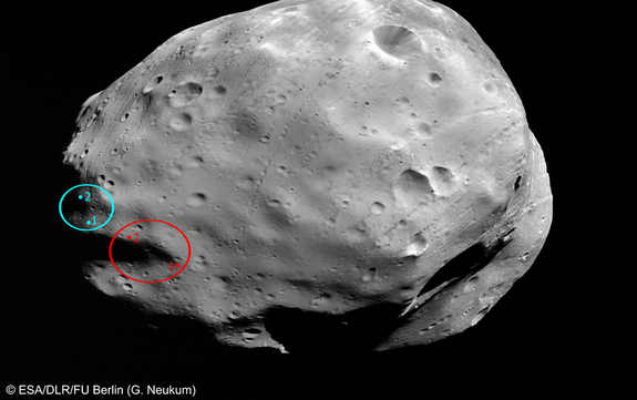 This picture of Phobos shows two possible landing sites for the Russian Phobos-Grunt mission. The oval in red marks a spot that was previously being considered, while the blue oval denotes the currently favored landing site.