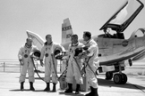 HL-10 pilots (left to right) Air Force Major Jerauld R. Gentry, Air Force test pilot Peter Hoag, and NASA pilots John A. Manke and Bill Dana. The HL-10 was one of five lifting body designs flown at NASA's Dryden Flight Research Center, Edwards, California, from July 1966 to November 1975 to study and validate the concept of safely maneuvering and landing a low lift-over-drag vehicle designed for re-entry from space.