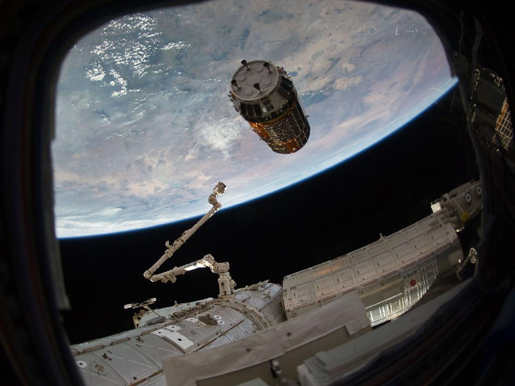 Canadarm2 Reaching for Kounotori2 H-II Transfer Vehicle (HTV2)