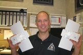 Man with a mission…to the moon. Stuart Spath, chief engineer for NASA's Gravity Recovery and Interior Laboratory (GRAIL) at Lockheed Martin Space Systems, holds small models of the GRAIL twosome.