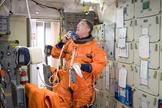 Mission Specialist Steve Bowen was picked to replace the injured Tim Kopra on the STS-133 flight. Here, he uses a communication system during a training session in the fixed-base shuttle mission simulator inside the Jake Garn Simulation and Training Facility at NASA's Johnson Space Center.