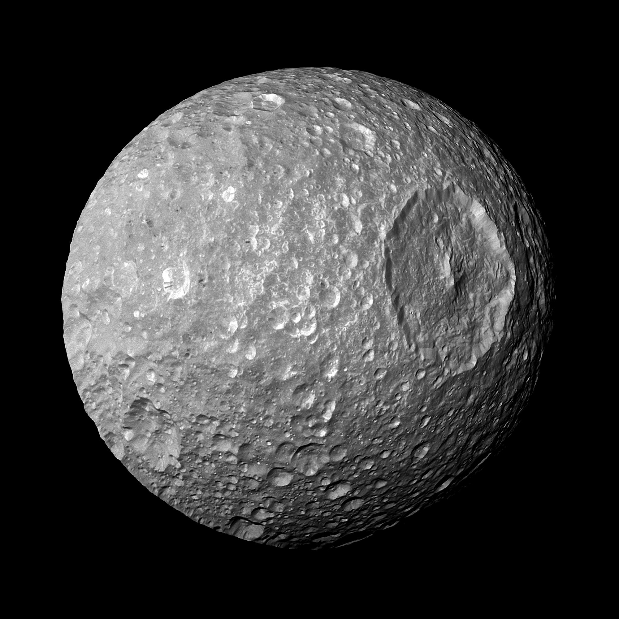 "Saturn's moon Mimas is dominated by a huge, unmistakable crater called Herschel  that makes the moon look like the Death Star in the movie ""Star Wars.""  On Feb. 13, 2010, NASA's Cassini spacecraft made  closest-ever flyby of Mimas, returning this photo an"