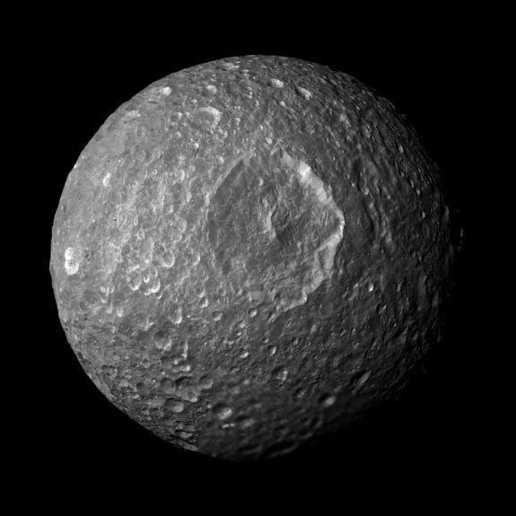 "This mosaic, created from images taken by NASA's Cassini spacecraft during its closest flyby of Saturn's moon Mimas on Feb. 13, 2010, looks straight at the moon's Herschel crater and reveals new insights about the moon's surface. Herschel crater gives Mimas its ""Death Star"" appearance. It is about 80 miles (130 kilometers) wide."