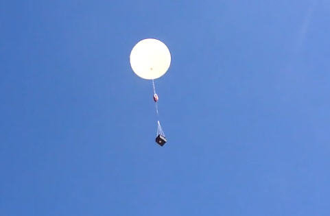 A shot of a previous Quest for Stars balloon mission rising toward the edge of space.