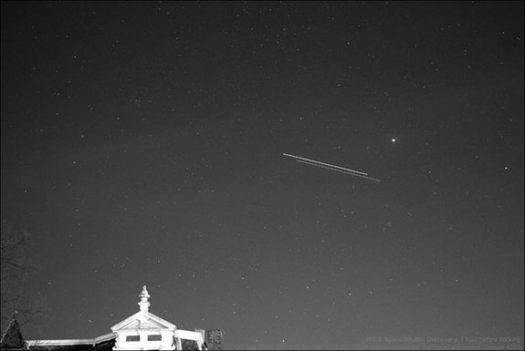 NASA's space shuttle Discovery and the International Space Station are seen in this time-lapse image as they fly over Leiden, The Netherlands, just before the two spacecraft docked on March 17, 2009 during the STS-119 mission. The shuttle is the object slightly fainter and lower in the sky. Movement is from right to left