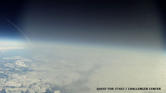 This frame grab from a video -- shot by a GoPro Hero Motorsport camera aboard the Robonaut-1 balloon -- shows the shuttle Discovery streaking toward space on its final mission. The shot was taken at 5:05 EST on Feb. 24, 2011 as the balloon was traveling through the troposphere -- hence the fog.