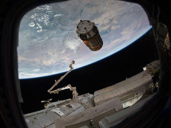Japan's HTV-2 robotic cargo ship is seen just before astronauts grapple it on Jan. 27, 2011. The spacecraft is one of several robotic cargo ships that ferry supplies to the International Space Station.
