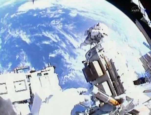 Spacewalking Astronauts Capture Space in a Bottle
