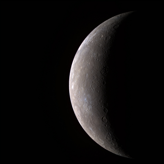 This visible-infrared image shows an incoming view of Mercury, about 80 minutes before MESSENGER's closest pass of the planet on Jan. 14, 2008, from a distance of about 27,000 kilometers (17,000 miles). The color image was generated by combining three separate images taken with different filters.