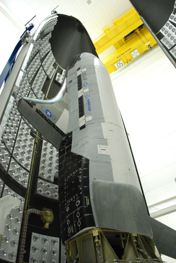 The second Boeing X-37B Orbital Test Vehicle, built for the U.S. Air Force, is shown here during encapsulation within the United Launch Alliance Atlas 5 rocket's  5-meter fairing at Astrotech in Titusville, Fla., on Feb. 8, 2011. The Air Force launched the new space plane from the nearby Cape Canaveral Air Force Station on March 5.