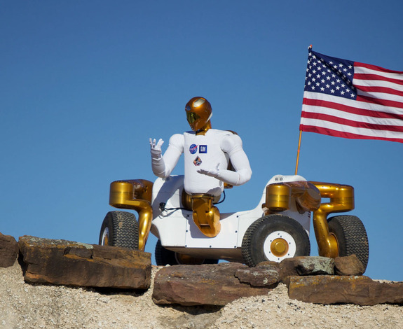 NASA's Robonaut 2 strikes a post atop its new wheeled base, Centaur 2, at the Johnson Space Center Planetary Analog Test Site in Houston. The Centaur base builds off of lessons learned through the Space Exploration Vehicle, a rover for astronauts, and could allow the dexterous humanoid robot to help with the future exploration of distant planetary surfaces.