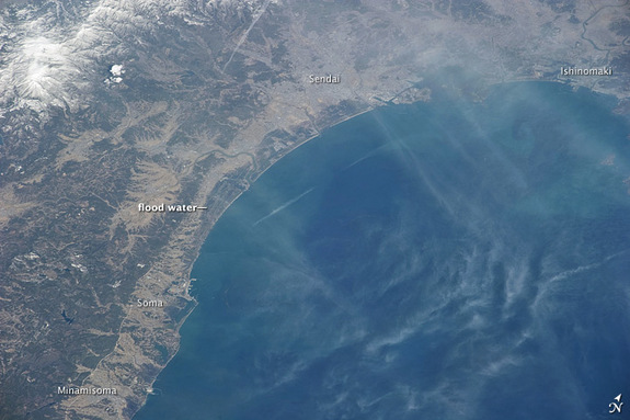 Through a thin haze of clouds, flooding was still discernible south of Sendai days after the massive 9.0-magnitude earthquake and resulting tsunami that struck on March 11, 2011. An Expedition 26 crew member took this photograph on March 14 from the International Space Station.