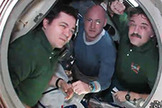 Expedition 26 crew members (from left) Oleg Skripochka, Scott Kelly and Alexander Kaleri bid farewell from inside the Soyuz TMA-01M spacecraft before closing the hatches on March 15, 2011. The crew landed on Earth on March 16.landed