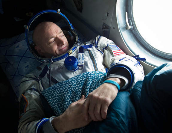 Expedition 26 commander Scott Kelly, wearing a turquoise wristband in honor of sister-in-law Gabrielle Giffords, looks out the window of a Russian Search and Rescue helicopter before the two hour helicopter ride to Kustanay, Kazakhstan shortly after he and fellow crew members Oleg Skripochka and Alexander Kaleri landed in their Soyuz TMA-01M capsule near the town of Arkalyk, Kazakhstan on Wednesday, March 16, 2011.
