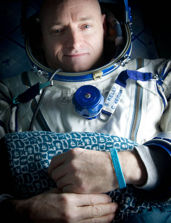 "Expedition 26 Commander Scott Kelly wears a blue wrist band that has a peace symbol, a heart and the word ""Gabby"" to show his love of his sister-in-law U.S. Rep. Gabrielle Giffords as he rests shortly after he and cosmonauts Oleg Skripochka and Alexander Kaleri landed in their Soyuz TMA-01M capsule  in Kazakhstan on March 16, 2011."