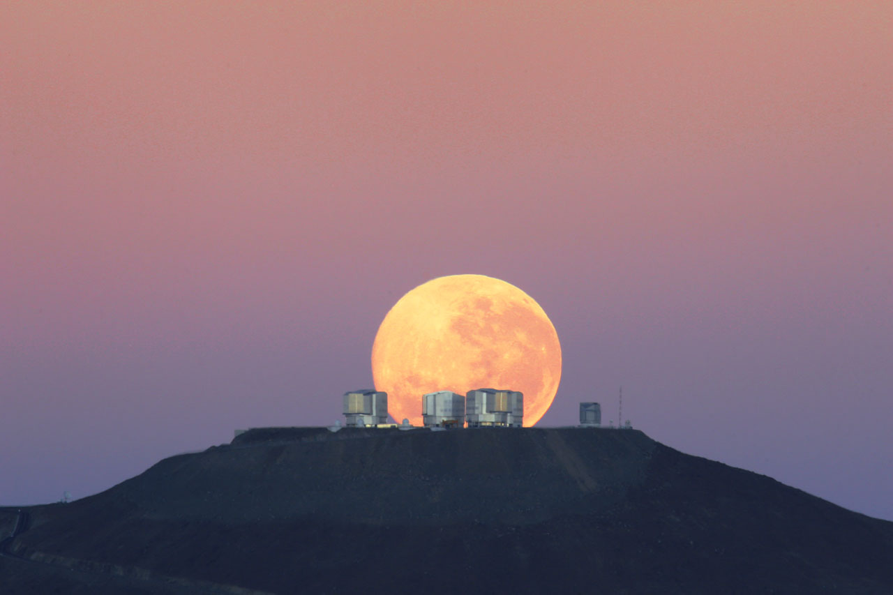 The moon sets on Cerro Paranal, home of ESO's Very Large Telescope (VLT), in Chile.