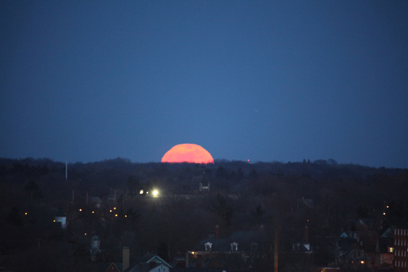 What appears to be an enormous full moon begins to rise over Grand Rapids, Michigan in this amazing photo from skywatcher Susan Wagener taken on  March 19, 2011.