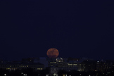 "Photographer Sandy Adams snapped this great view of the ""supermoon"" full moon of March 19, 2011 rising over Washington, D.C."