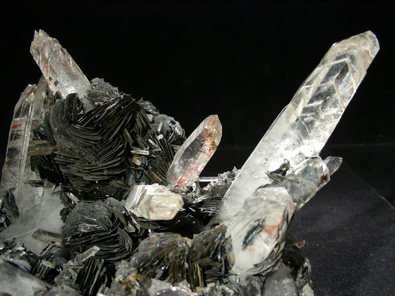 Quartz crystals growing out of hematite.