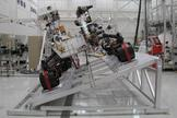 The image shows Curiosity on a tilt table in the Spacecraft Assembly Facility at NASA's Jet Propulsion Laboratory, Pasadena, California.