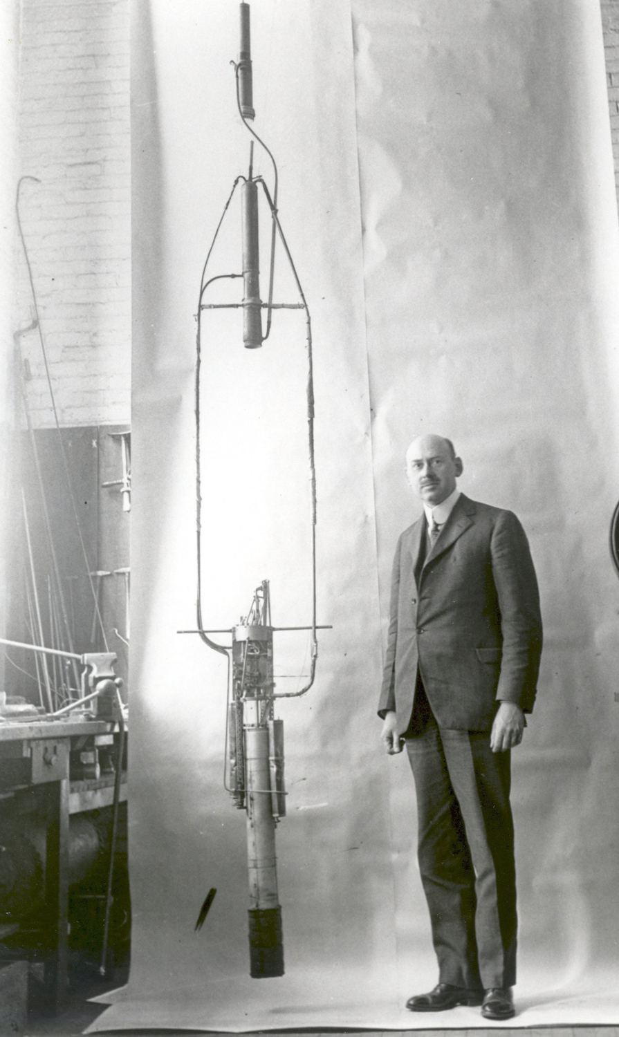 Robert Goddard with his Double Acting Engine Rocket