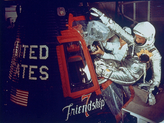 On Feb. 20, 1962, John Glenn rode the Friendship 7 capsule into space, the first time an American orbited the Earth. In this image, Glenn enters the capsule with assistance from technicians.