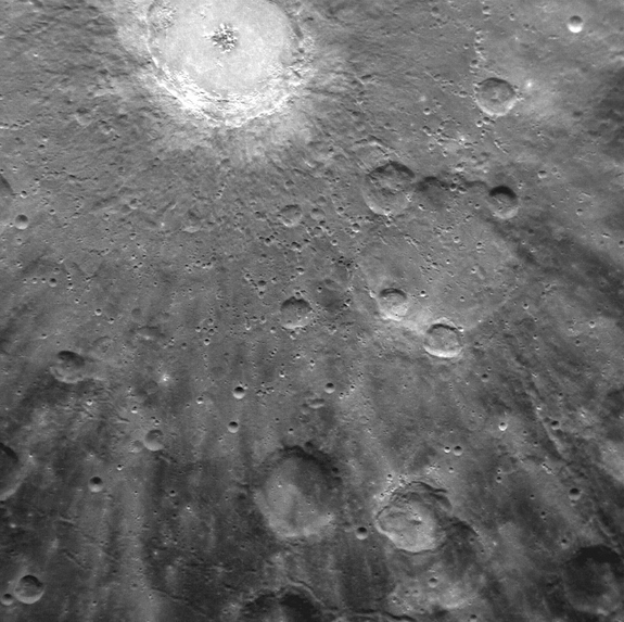 Bright rays, consisting of impact ejecta and secondary craters, radiate from Mercury's Debussy crater, located at the top. The image, acquired by NASA's Messenger spacecraft on March 29, 2011, shows a small portion of Debussy's large system of rays in greater detail than ever before.