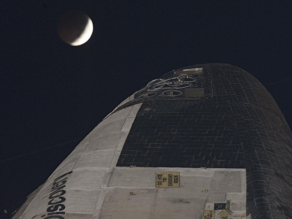 Shuttle Discovery and the Lunar Eclipse