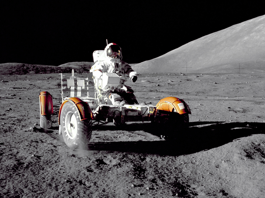 Apollo 17 mission commander Eugene A. Cernan makes a short checkout of the Lunar Roving Vehicle during the early part of the first Apollo 17 extravehicular activity at the Taurus-Littrow landing site in 1972.