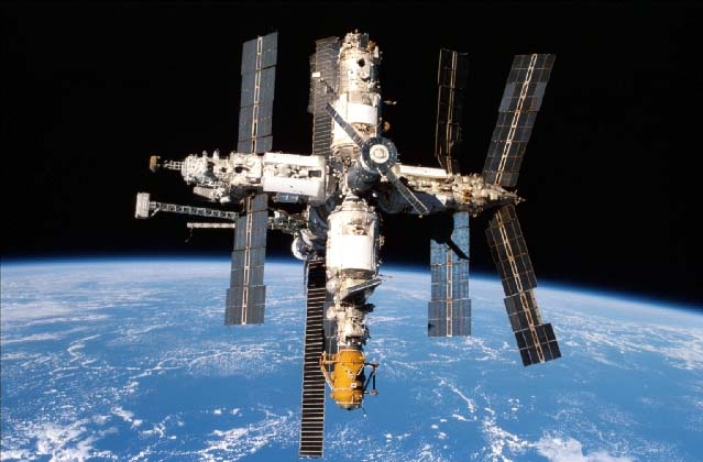 The Mir Space Station and Earth limb observed from the Orbiter Endeavour during NASA's STS-89 mission in 1998.