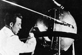 A Soviet technician works on Sputnik 1 before the satellite's Oct. 4, 1957 launch.