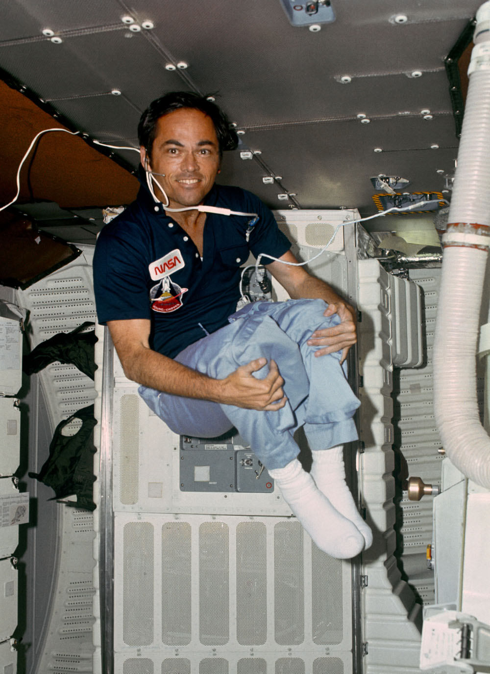 Astronaut Robert L. Crippen, pilot for STS-1 takes advantage of zero-gravity to do some rare acrobatics on the middeck of the space shuttle Columbia in Earth orbit during the two-day mission between April 12 and April 14 in 1981.