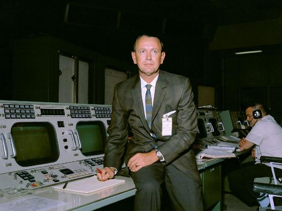 Dr. Christopher C. Kraft Jr. is seen at his Flight Director console in the Mission Control Center during Gemini-Titan V flight simulation.