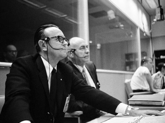 Dr. Robert R. Gilruth (right), MSC Director, sits with Dr. Christopher C. Kraft Jr., MSC director of flight operations, at his flight operations director console in the Mission Control Center during the Apollo 5 unmanned space mission.
