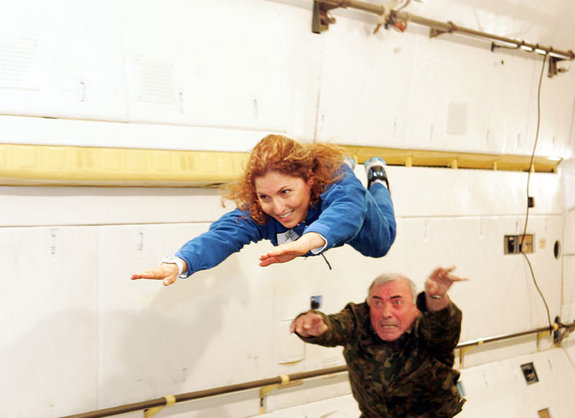 Ansari X Prize backer Anousheh Ansari gets a push during weightless training aboard a modified aircraft. She flew to the ISS on Sept. 18, 2006 - the world's first female private spaceflyer.
