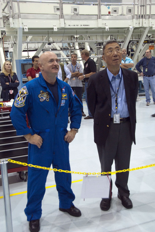 Endeavour shuttle commander Mark Kelly, left, and Nobel laureate Sam Ting (principal investigator for the Alpha Magnetic Spectrometer) look over the instrument as it sits in a work stand at NASA's Kennedy Space Center in Florida. Kelly will command the STS-134 mission to take the AMS to the International Space Station. The cutting edge instrument is the brainchild of Ting.