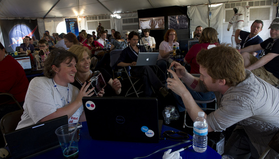 Actor Seth Green, right, takes a quick photo of two NASA Tweeps holding a Golden Orb Spider during the STS-134 Tweetup, Thursday, April 28, 2011, at Kennedy Space Center in Cape Canaveral, Fla., one day before the final launch of shuttle Endeavour.