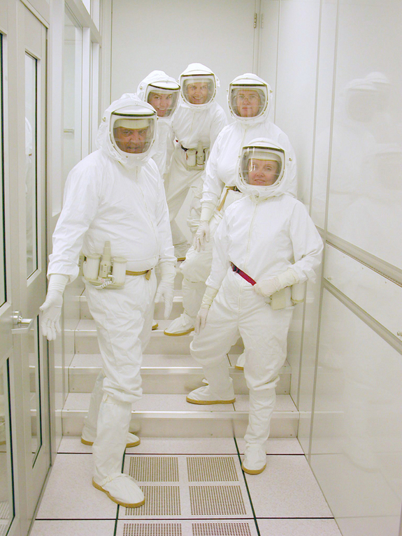 Dressed for the occasion! Today's well-garbed NASA sample return analysis team is much more effective at detecting microbes while avoiding cross-contamination.