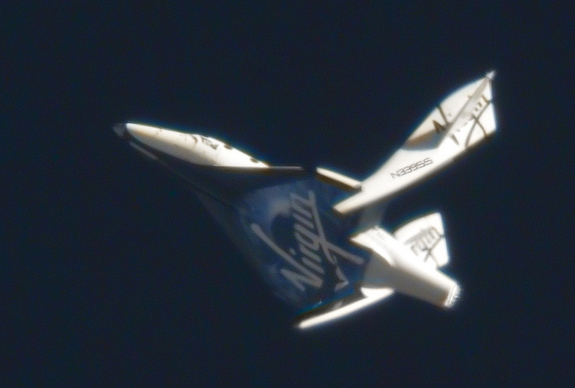 Virgin Galactic's suborbital passenger ship SpaceShipTwo flexes its feathered re-entry system during a pivotal glide test at the Mojave Air and Space Port in California on May 4, 2011.