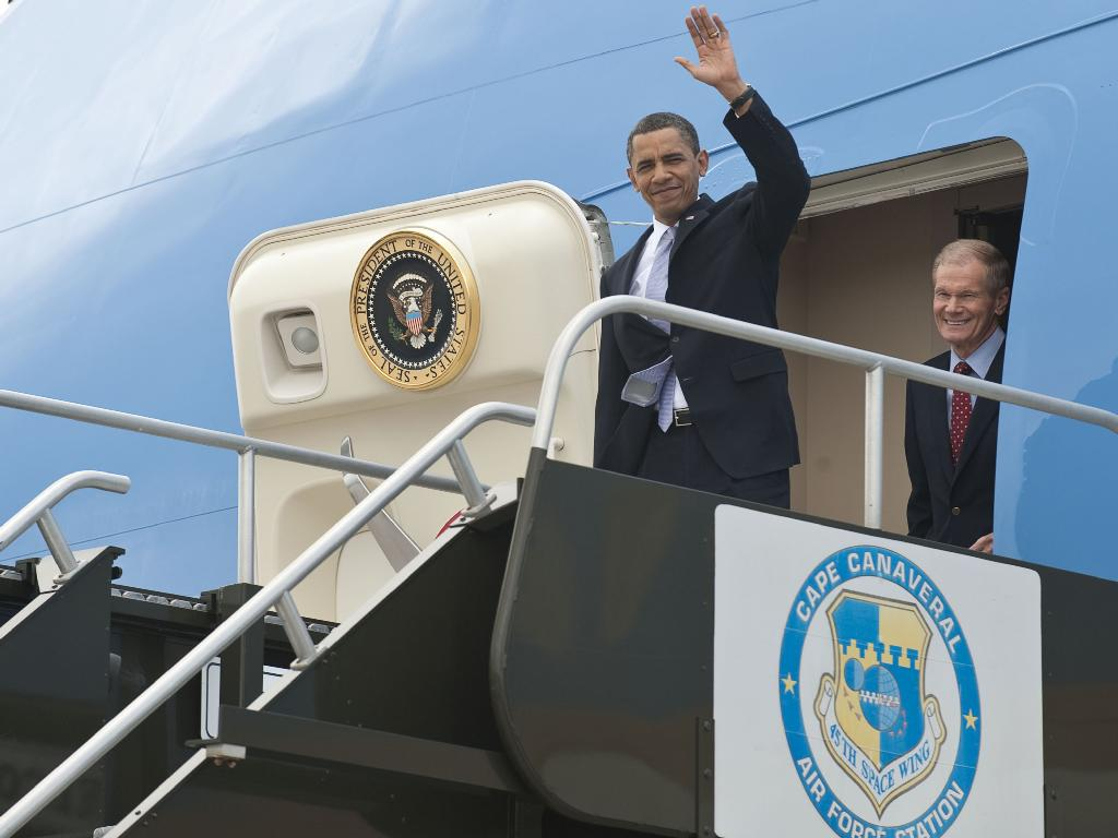 President Barack Obama Waves From Air Force One