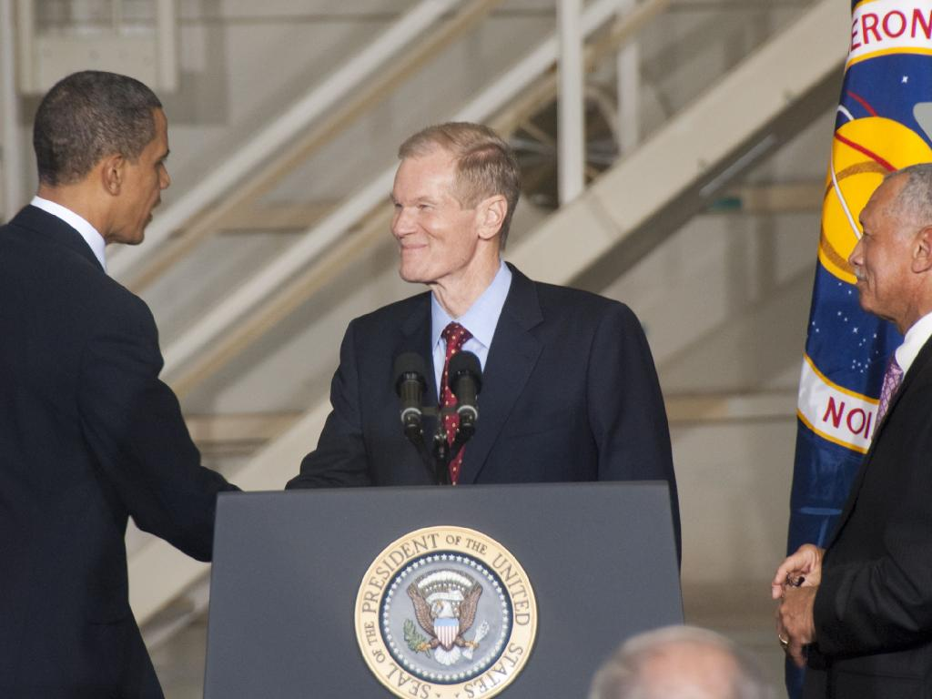 Senator Bill Nelson at the Podium Shakes Hands with the President
