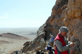 Looking for trilobites and other ancient marine fossils on a mud mound in Morocco.
