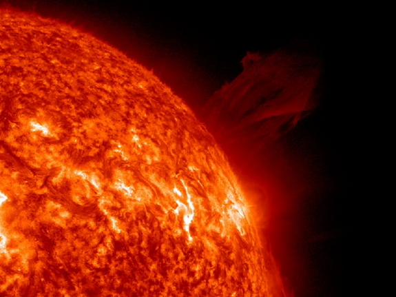 This image from the SOHO spacecraft shows a huge coronal mass ejection erupt from the sun's surface shortly before a comet dove towards the sun and disappeared. The solar explosion occurred before the comet was close enough to have any impact, NASA officials say.