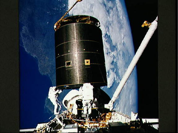 Endeavour's STS-49 crew captures the INTELSAT VI satellite above the shuttle's payload bay.
