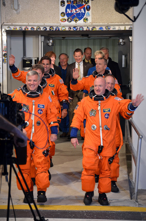 "The six astronauts of Endeavour's STS-134 mission - the final flight of NASA's youngest orbiter - depart the Operations & Checkout building at NASA's Kennedy Space Center in Cape Canaveral, Fla. on May 16. The astronauts boarded the ""Astro Van"" at 5:11 a.m. EDT to journey to Endeavour's seaside Launch Pad 39A."