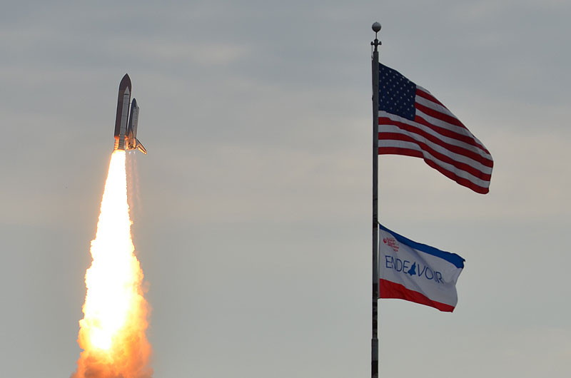Endeavour Flies Past Flags